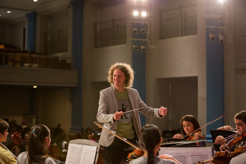 Conductor with the DC Youth Orchestra Program